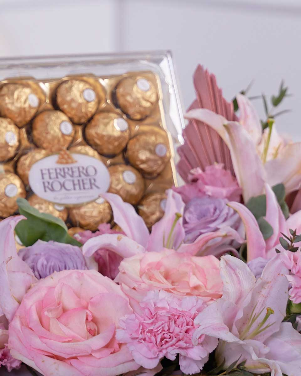 dried palm, roses, lilies, and chocolates