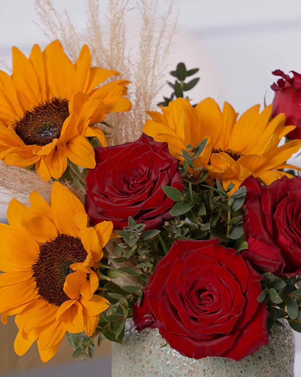 sunflower, pampas and red roses close up photo