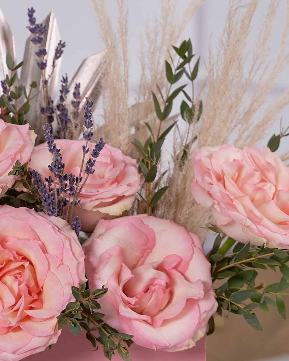 laveder and roses on pink box close up photo