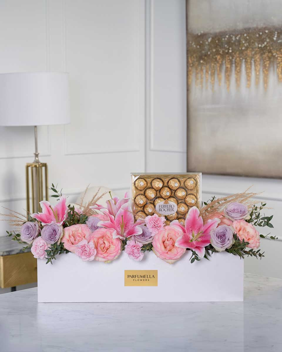 photo of flowers and chocolate on white box