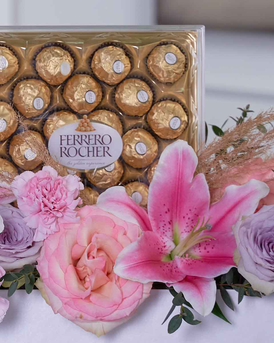 detailed photo of flowers and chocolate on white box