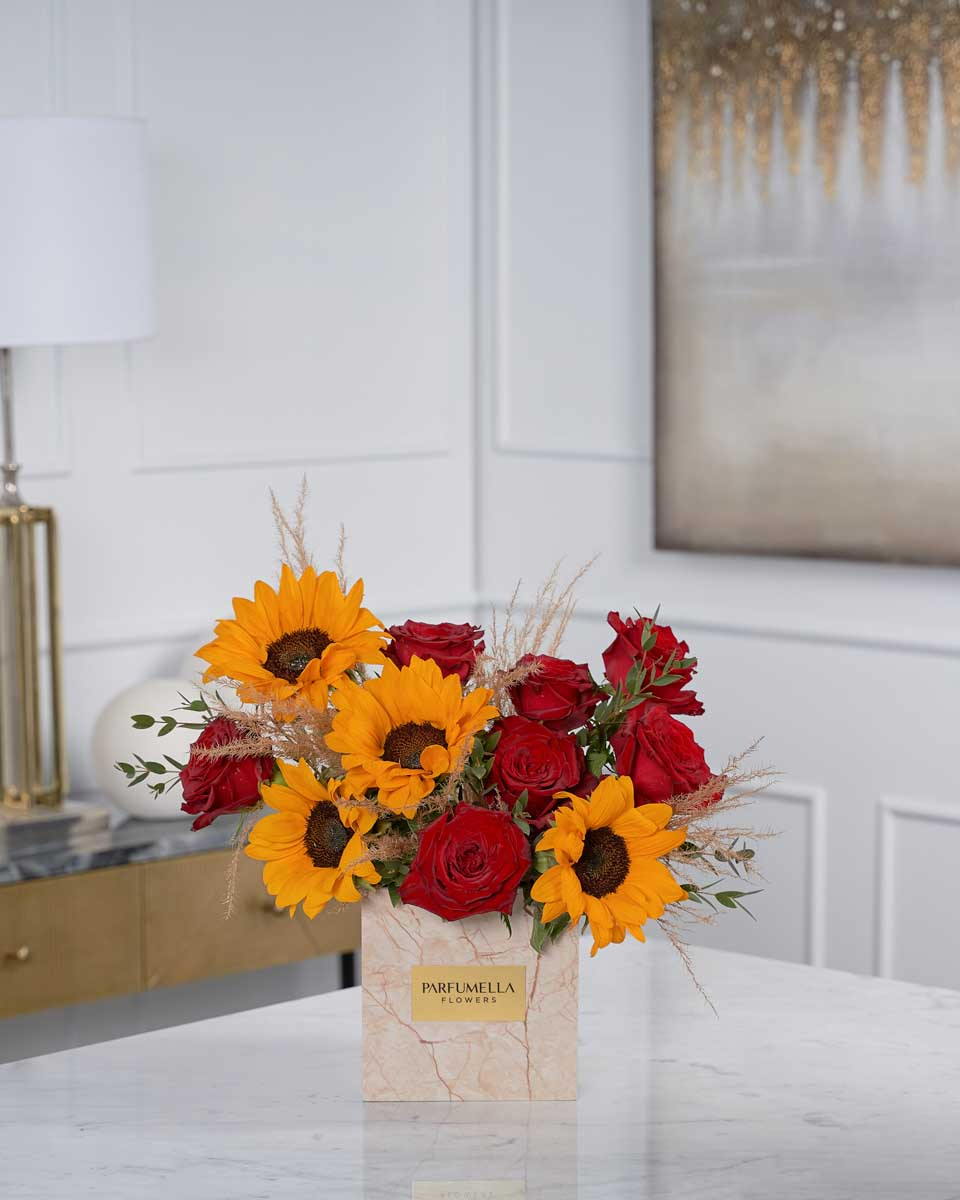 roses, pampas and sun flower on beige marble box