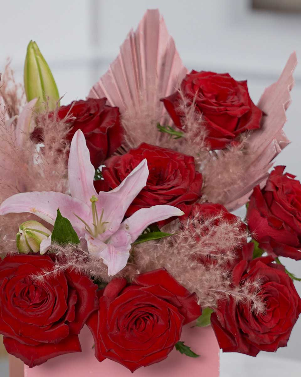 roses, lilies, pampas and dried palm close up photo