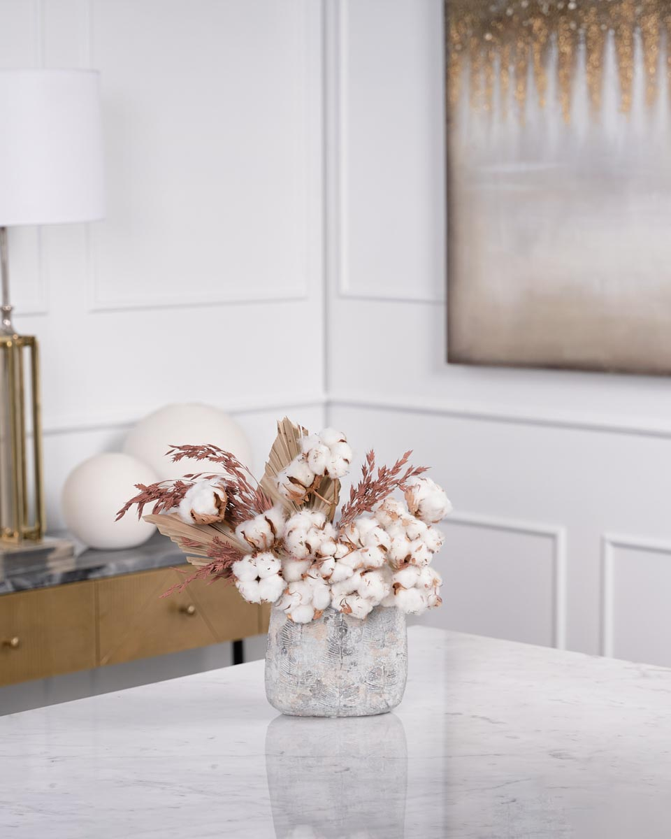 cotton sticks and dried palm on vase